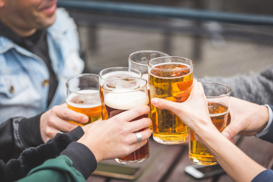 Liquor Liability Insurance - Group of Friends Cheering with a Beer