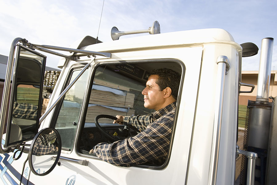 Business Insurance - View Of Truck Driver Driving His Truck